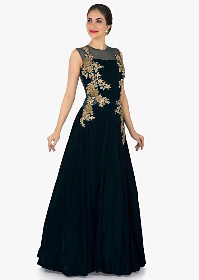 Bottle green gown in velvet with embroidered side bodice only on Kalki