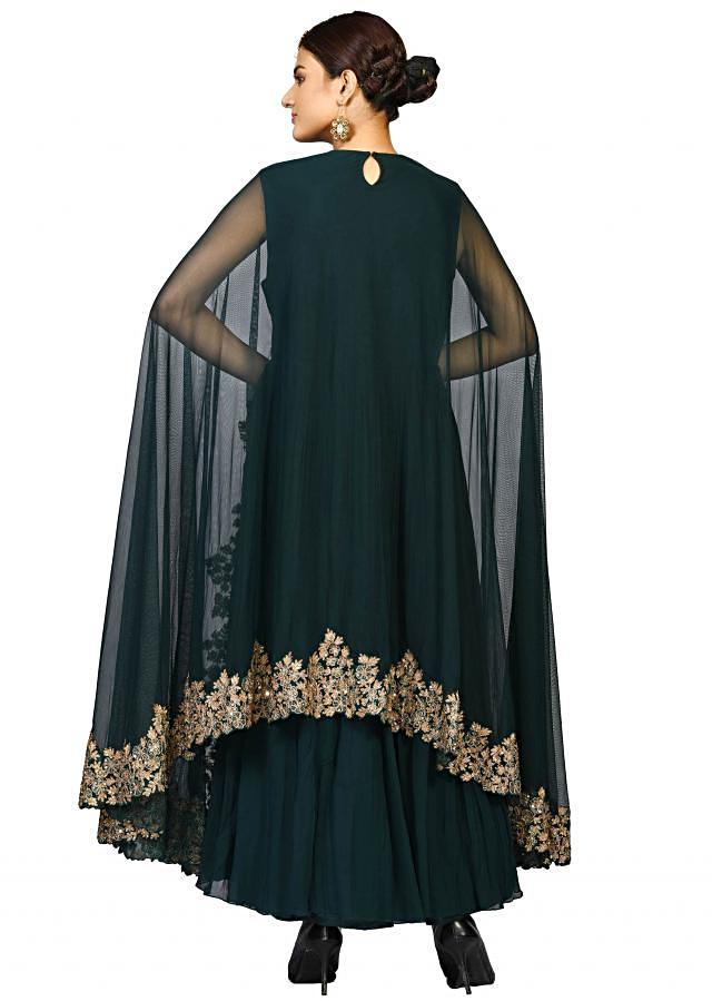 Bottle green net suit with long cape sleeves embellished in zari and tikki work only on Kalki