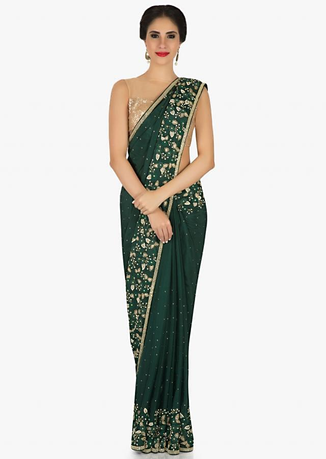 Bottle green saree in satin chiffon with resham floral embroidery only on Kalki