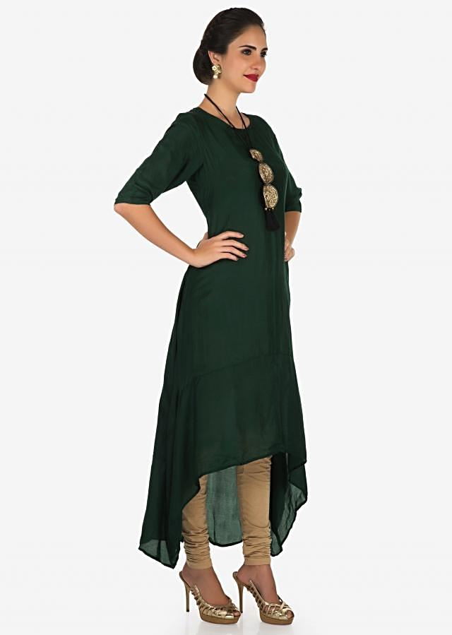 Bottle green tunic in cotton with fancy tasseled neck piece only on Kalki