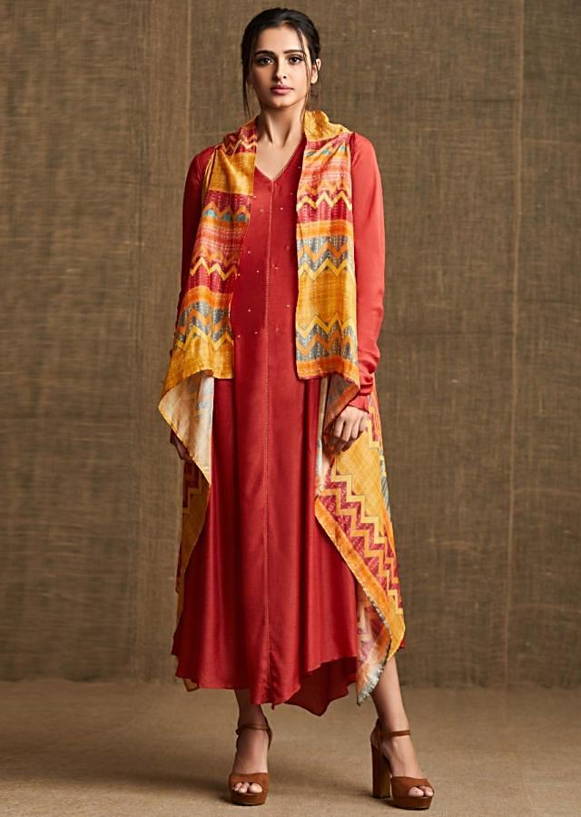 Brick red long dress matched with front short and back long printed jacket