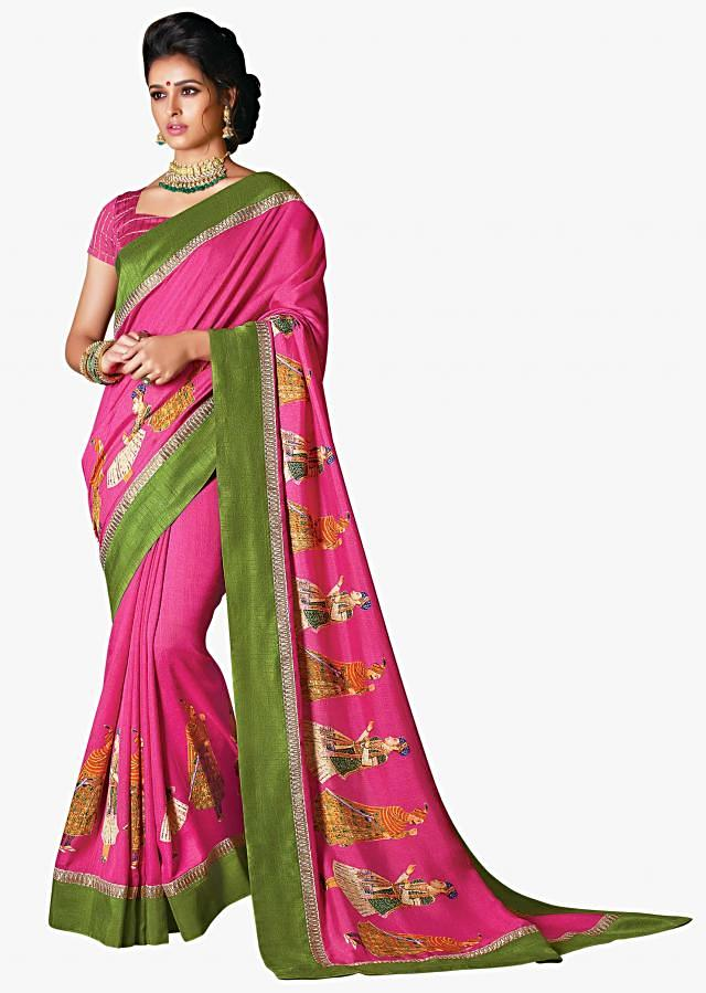 Bright pink saree in silk with human motif print and contrast border
