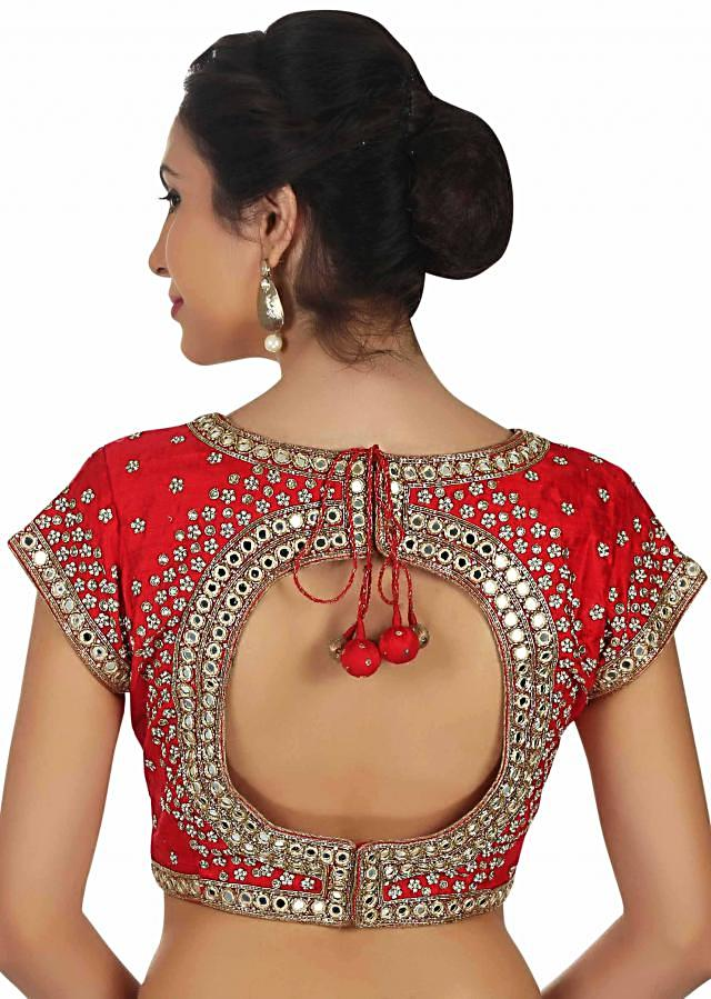 Bright red blouse in mirror embroidered neckline only on Kalki
