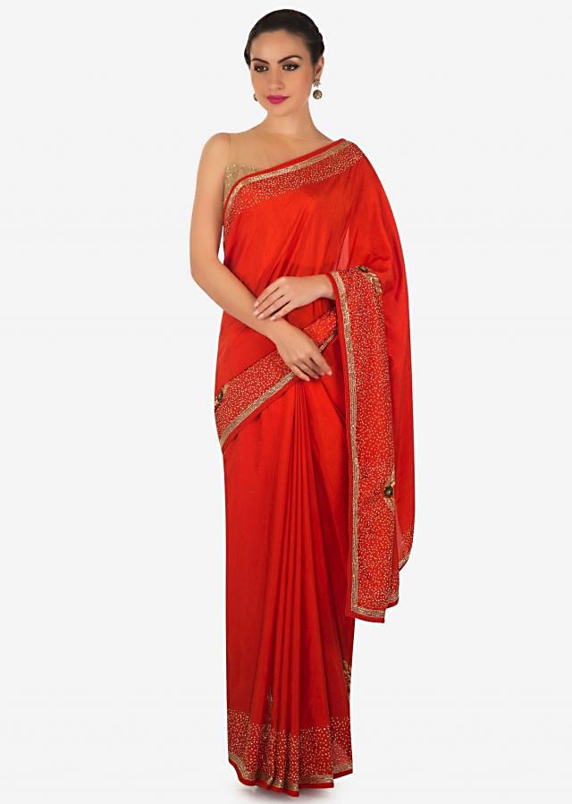Bright orange saree in silk with cut dana and resham embroidered butti only on Kalki