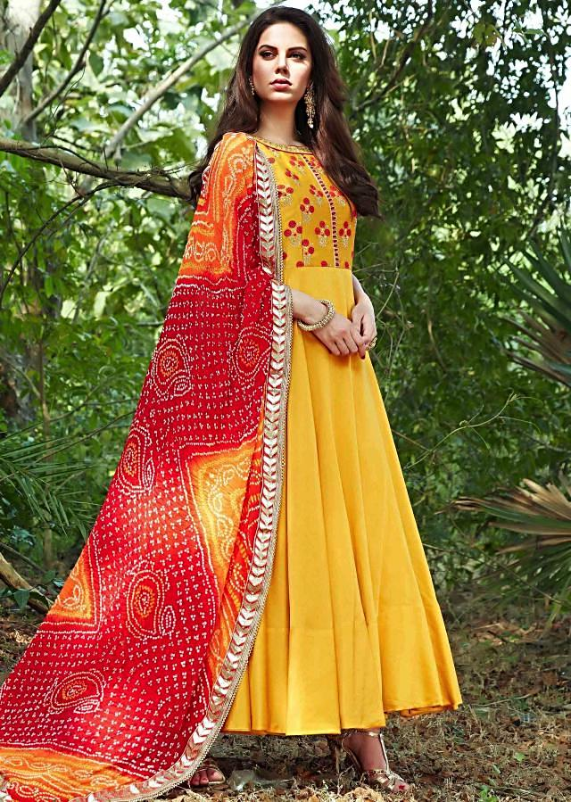 Bright yellow anarkali suit with embroidered bodice and bandhani dupatta