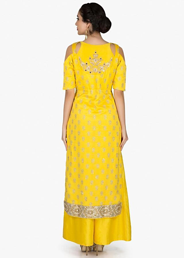 Bright yellow straight palazzo suit embellished in zari butti and border only on Kalki