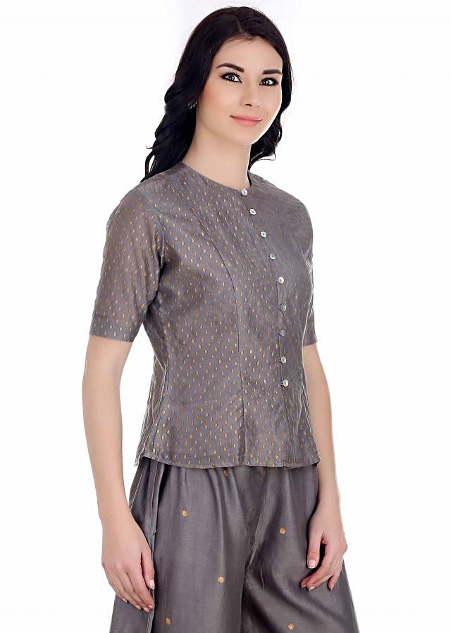 Bring on your dose of tradition with this grey button down top