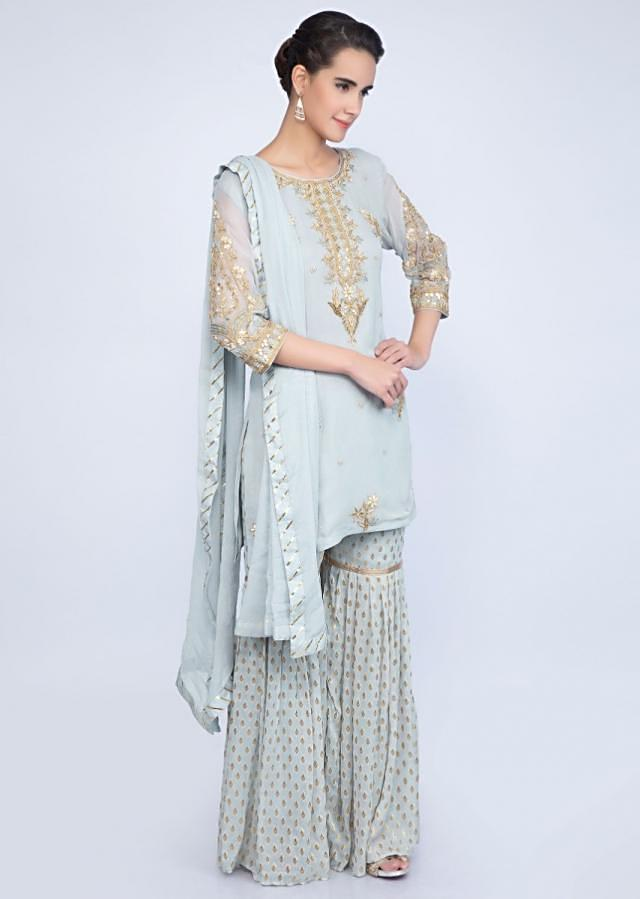 Brittany blue embroidered georgettes suit weaved sharara and chiffon dupatta only on Kalki