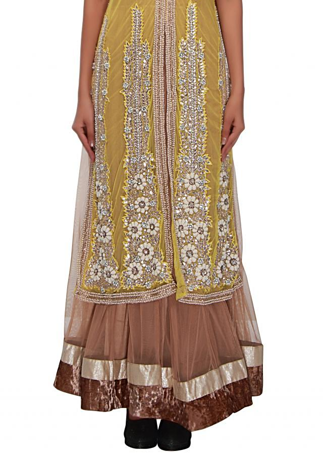 Brown anarkali suit matched with yellow embroidered jacket only on Kalki