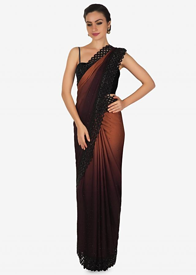 Brown and purple saree in satin with black cut work lace border only on Kalki