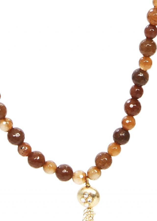 Brown beads long mala that works on soft linen color dresses as well as our one color semi formal gowns only on Kalki