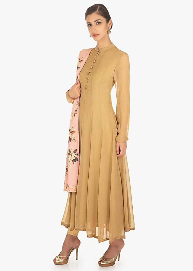 Brown georgette suit in kali paired with a contrasting pink cotton silk floral printed dupatta only on Kalki