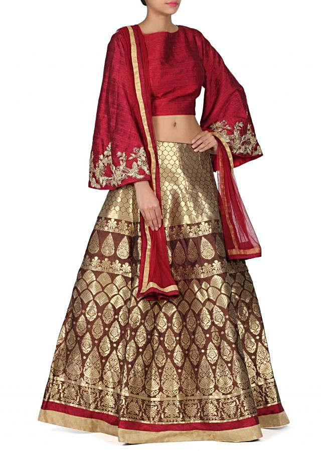 Brown lehenga matched with crop top blouse only on Kalki