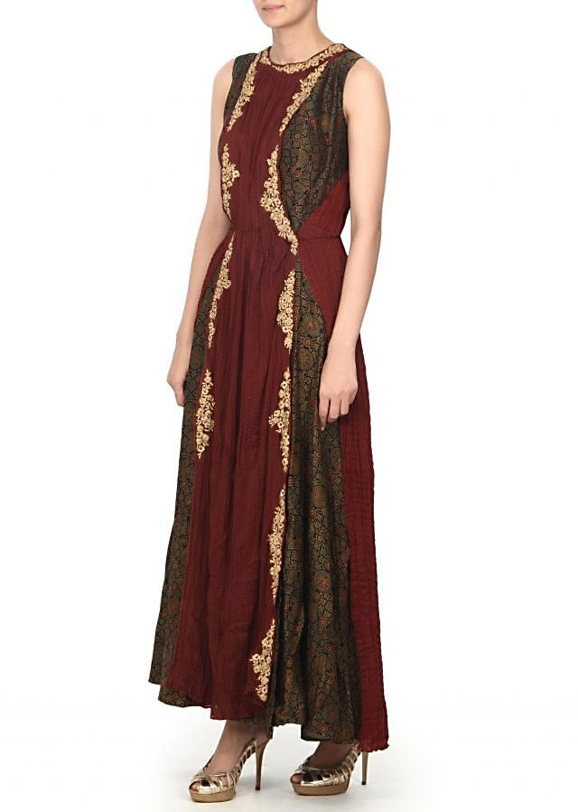 Brown suit enahcend in zari and print only on Kalki