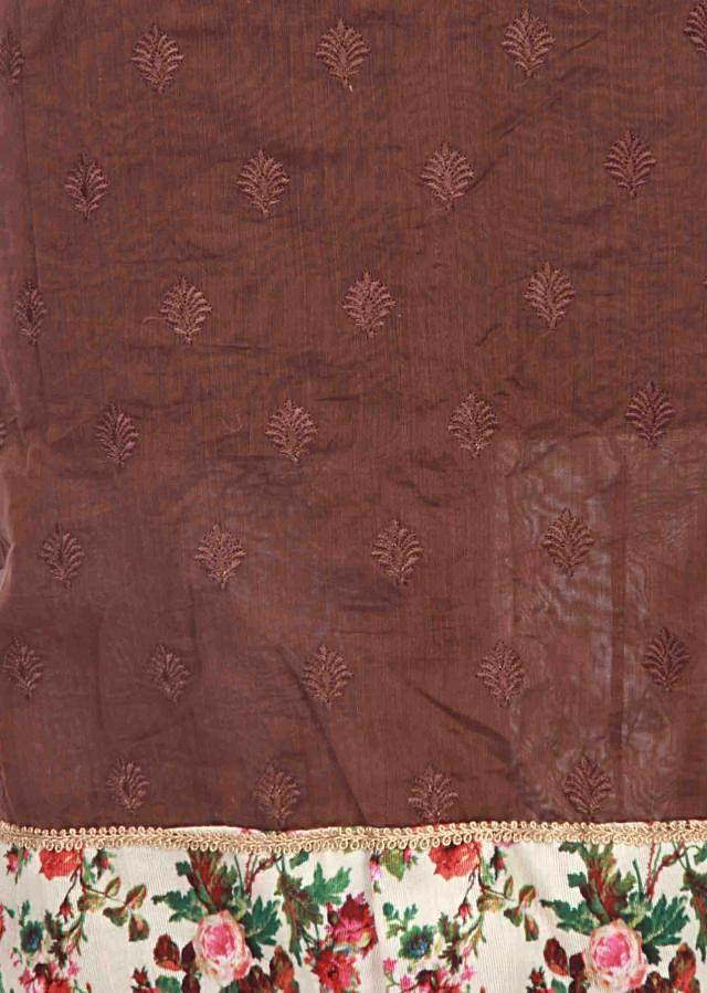 Brown unstitched suit enhanced in resham and print only on Kalki