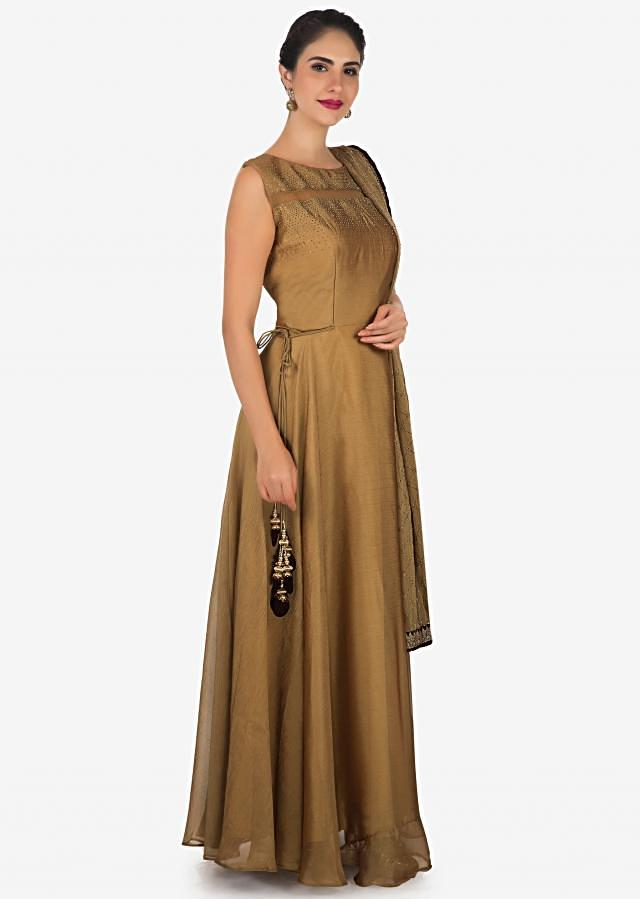 Brown anarkali suit in chiffon with yoke highlighted in sheer net and kundan only on Kalki