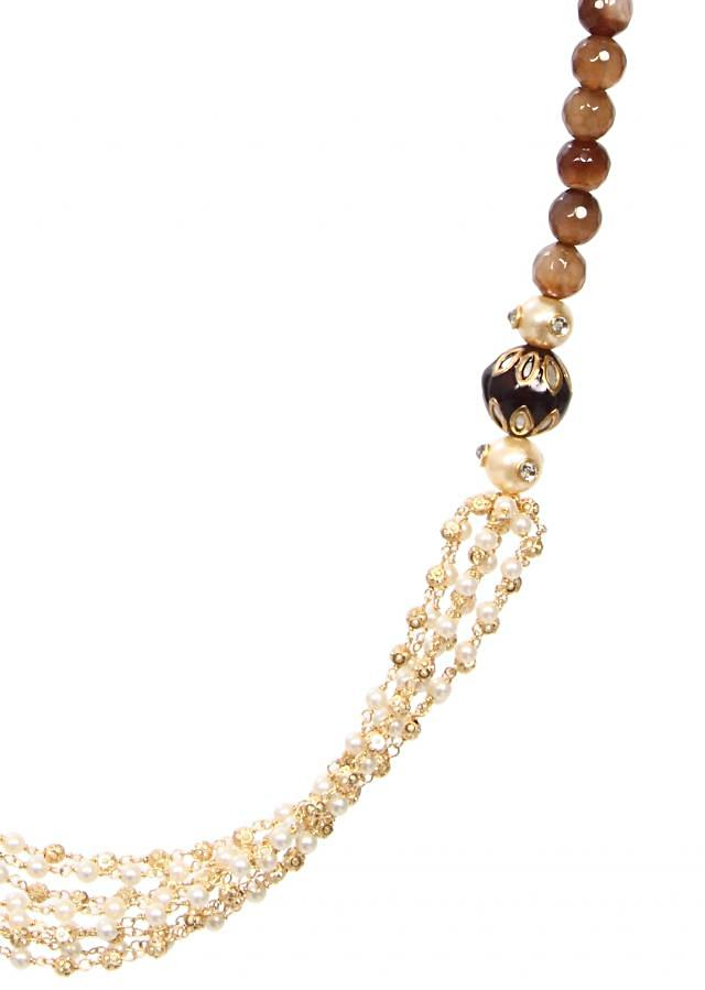 Brown beads with white combination works well as contrast or on plain attire only on Kalki