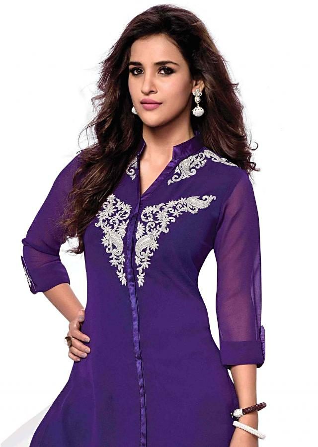Bue kurti features with embroidered butti only on Kalki