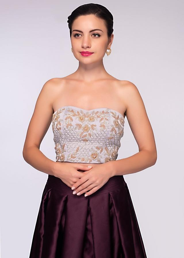 Burgundy satin crepe skirt paired with strapless satin crop top and grey organza jacket only on Kalki