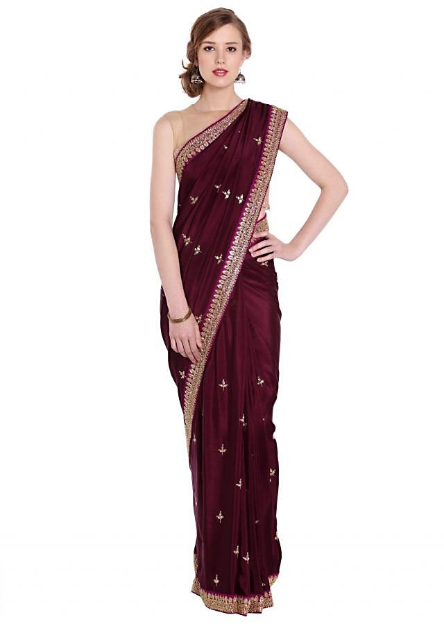 Burgundy satin silk saree in zari and sequin embroidery in jaal motif only on Kalki