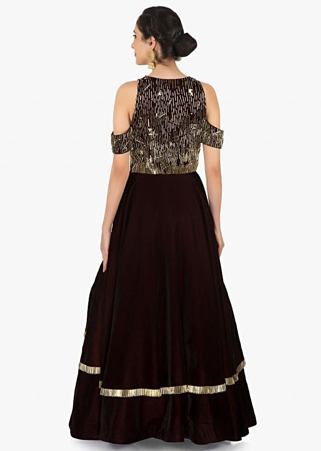 Burgundy gown in velvet featuring the tassel lace only on Kalki