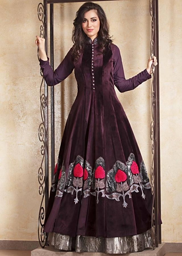 Burgundy long velvet jacket in french knot work matched with silver lehenga