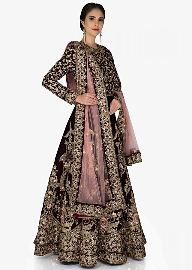 Burgundy Velvet Gown and Pink Net Dupatta with Resham, Zari and Cut Dana only on Kalki