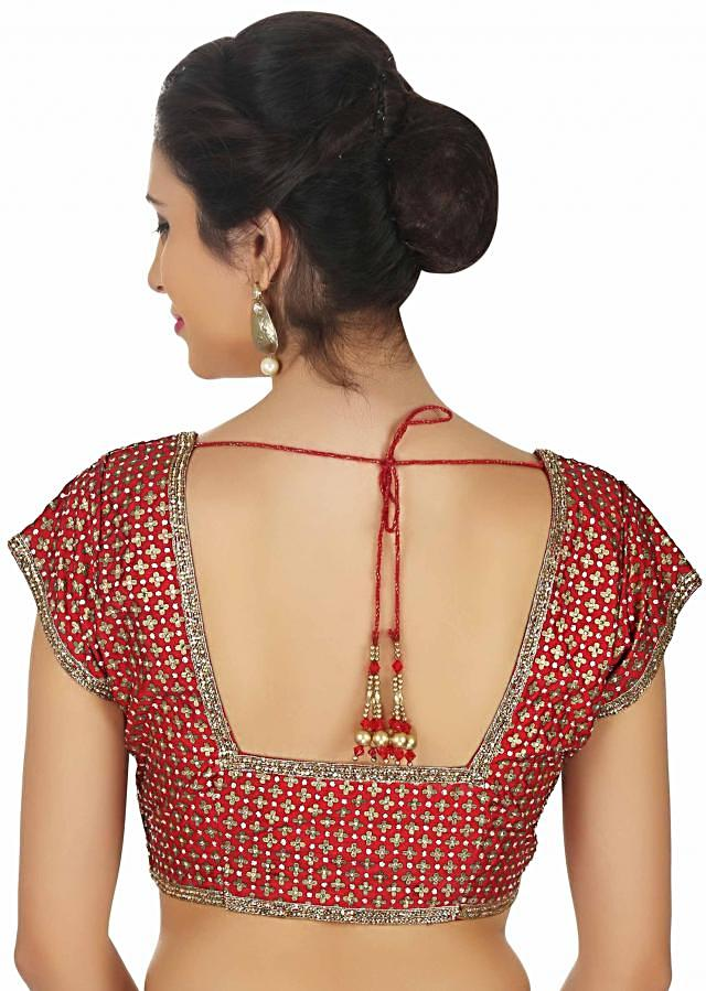 Burnt red blouse embellished in sequin and motif work all over only on Kalki