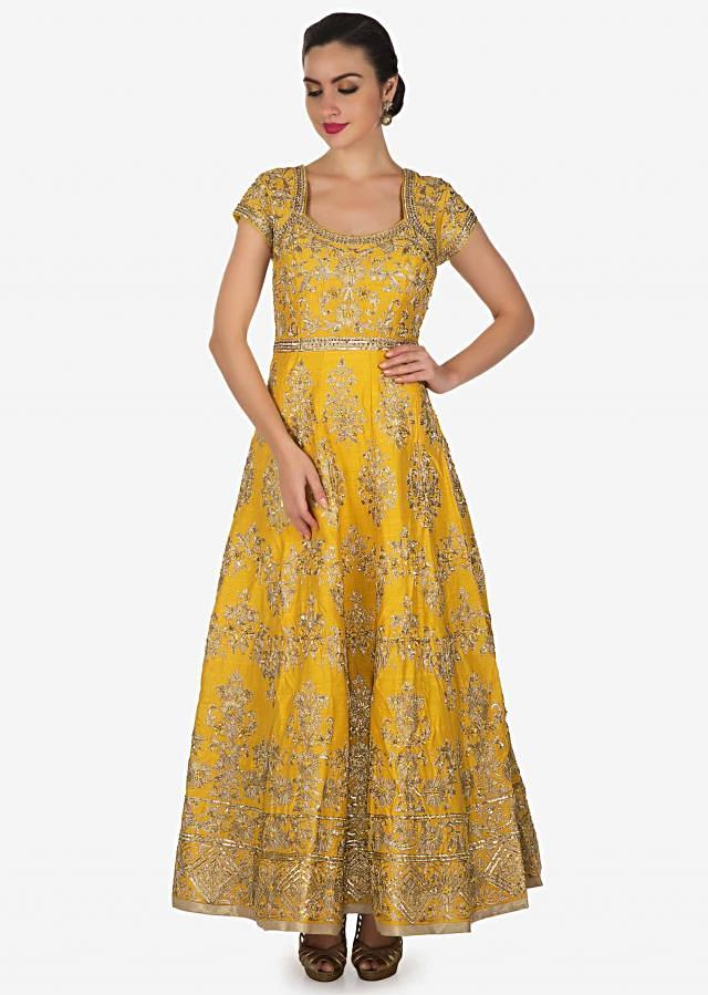Butter yellow anarkali suit in raw silk adorn in gotta lace and sequin work only on Kalki
