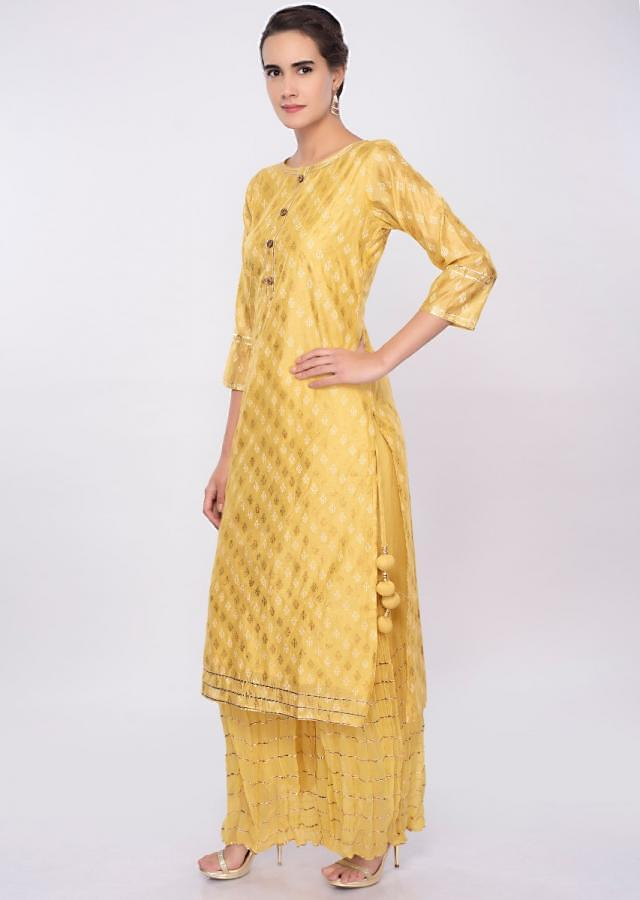 Butter yellow foil printed suit with crushed georgette palazzo only on Kalki