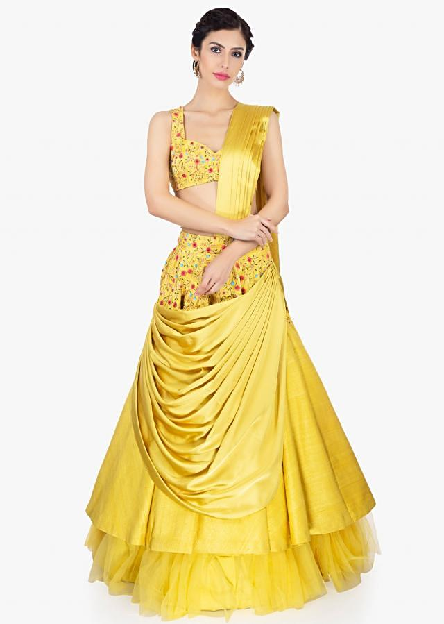Butterscotch yellow multi layered lehenga paired with embroidered blouse and net dupatta only on Kalki