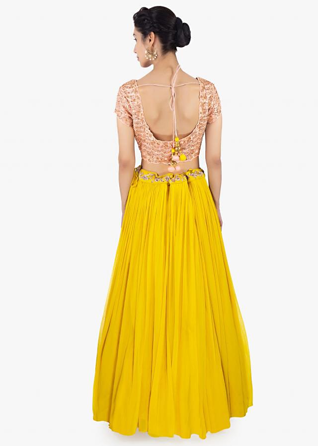 Canary Yellow Skirt Ingeorgette Paired With A Peach Top And Peach Net Dupatta Online - Kalki Fashion