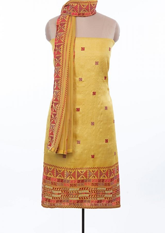 Canary yellow unstitched tussar silk suit set with multi color embroidery and butti only on Kalki