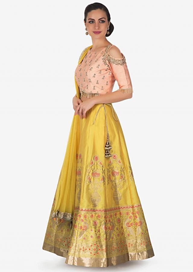 Canary yellow lehenga in silk with peach embroidered blouse only on Kalki