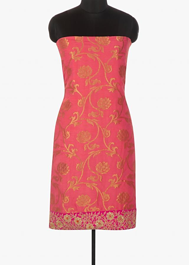Candy pink unstitched suit in brocade georgette with embroidered hem line only on Kalki