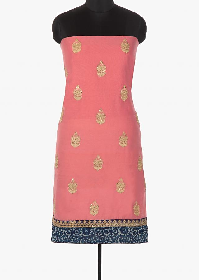 Candy pink unstitched suit with embroidered butti and indigo printed hem line only on Kalki