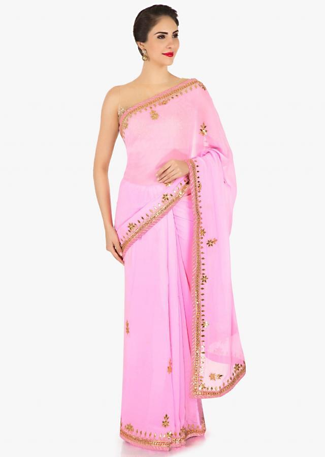 Candy pink saree in georgette with gotta patch embroidery only on Kalki