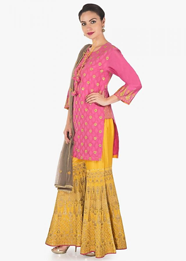 Candy pink straight suit with yellow palazzo pant and contrast grey net dupatta only on Kalki