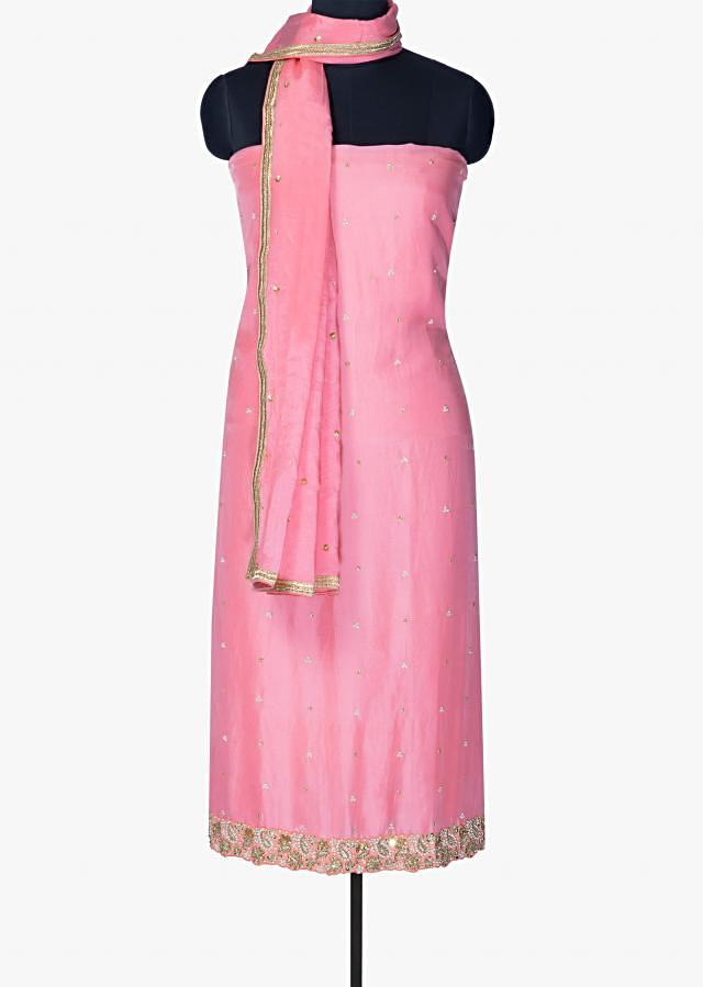 Candy pink unstitched suit with paisley motif border only on Kalki