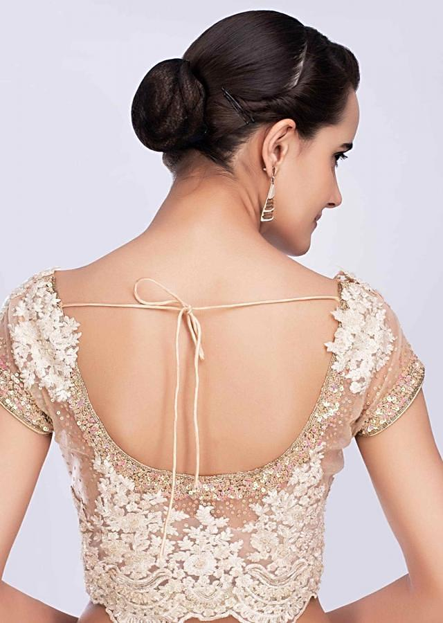 Champagne cream sheer net saree with scattered sequins all over only on Kalki