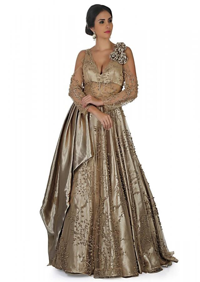 Champagne gold gown in embroidered net and pearl work only on Kalki