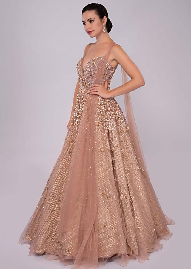 Champagne beige embroidered net gown with front and back attached drape only on Kalki