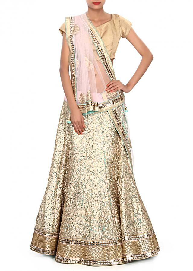 Champaign gold lehenga embellished in sequin embroidery only on Kalki