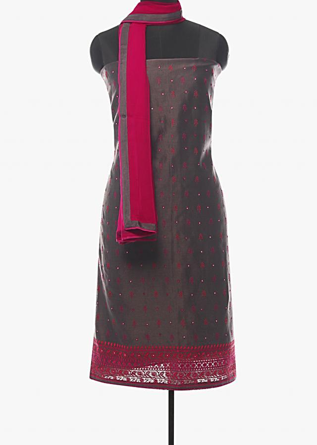 Charcoal grey unstitched suit in embroidered butti and border work only on Kalki