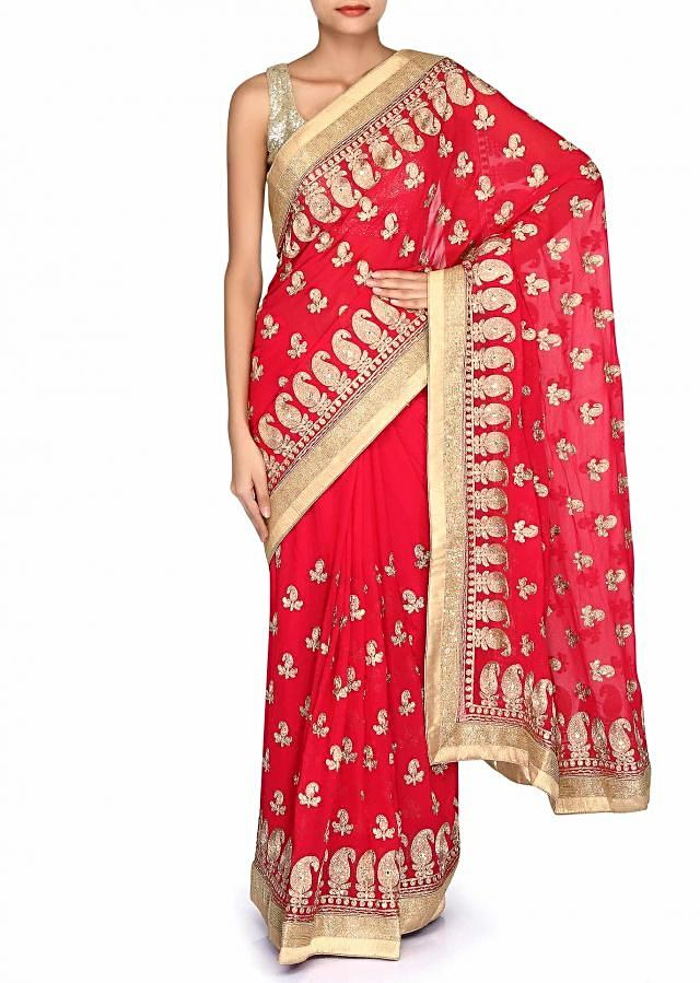 Cherry red saree adorn in aari embroidery only on Kalki
