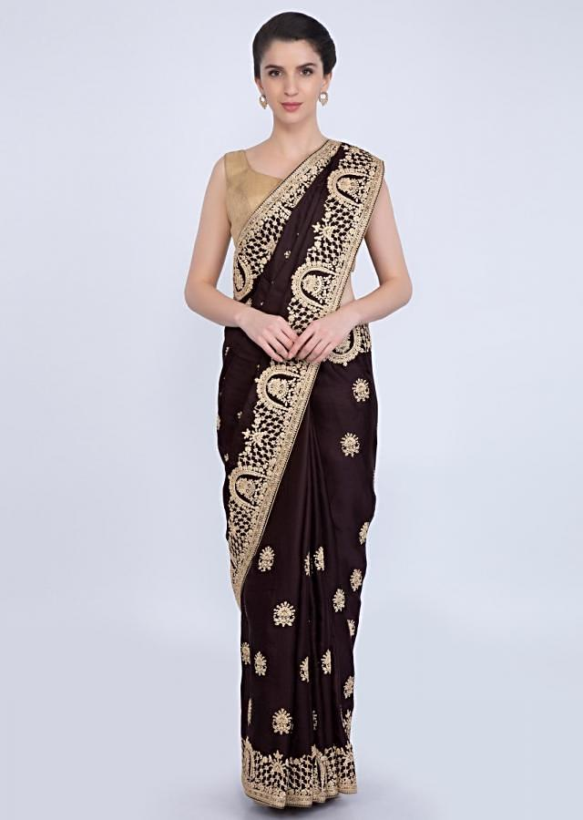 Chocolate brown tussar satin silk saree with floral butti and temple border only on kalki