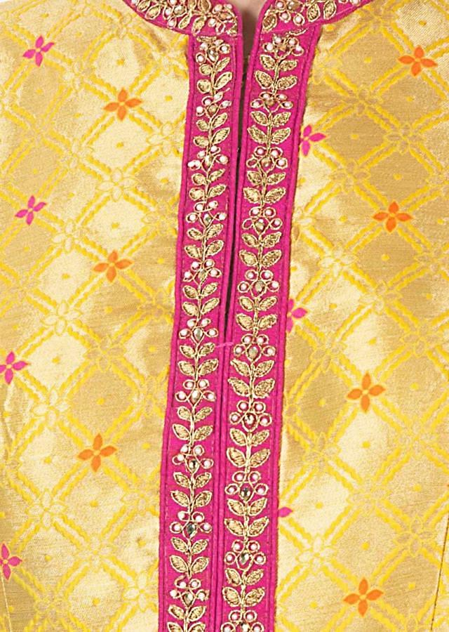 Chrome yellow anarkali suit matched with rani pink brocade dupatta only on Kalki