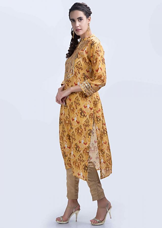 Chrome yellow batik printed kurti with lace embroidered placket only on Kalki