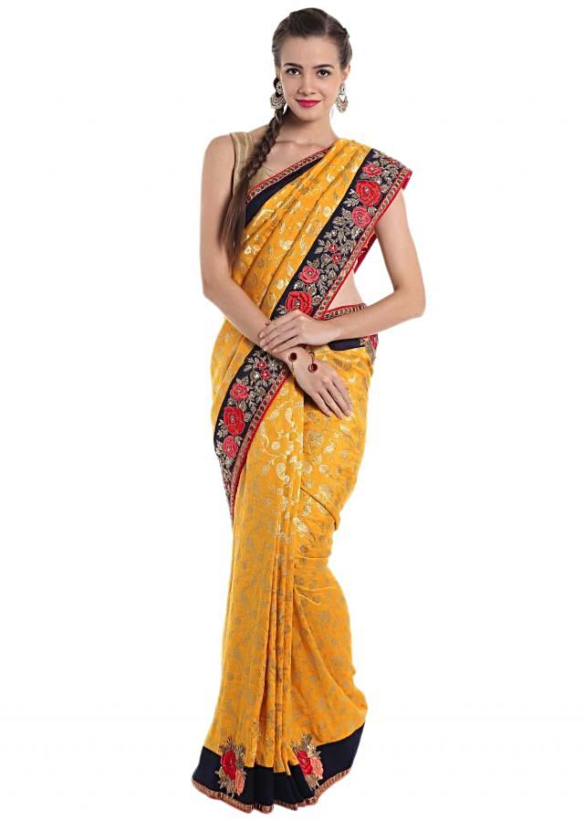 Chrome yellow brocade silk saree crafted with resham and sequin work only on Kalki