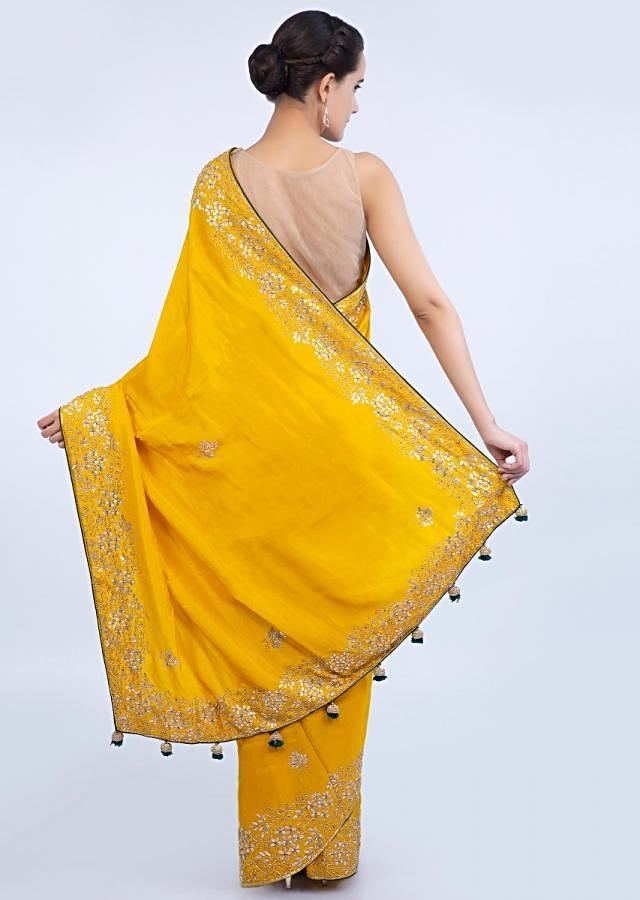 Chrome yellow silk saree with floral embroidered butti and border only on Kalki